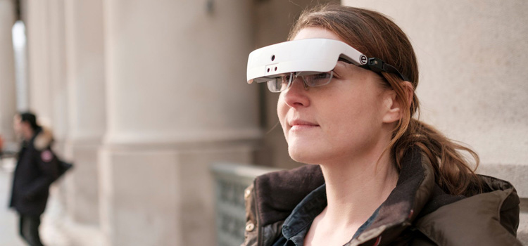 Woman wearing the eSight device