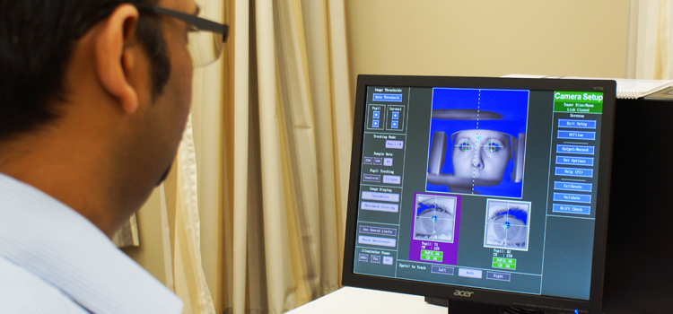 Researcher viewing a computer screen.