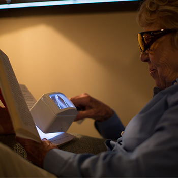 Women using a lighted magnifier