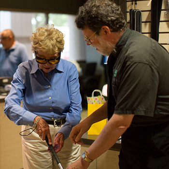 photo of a woman learning to use a mobility cane